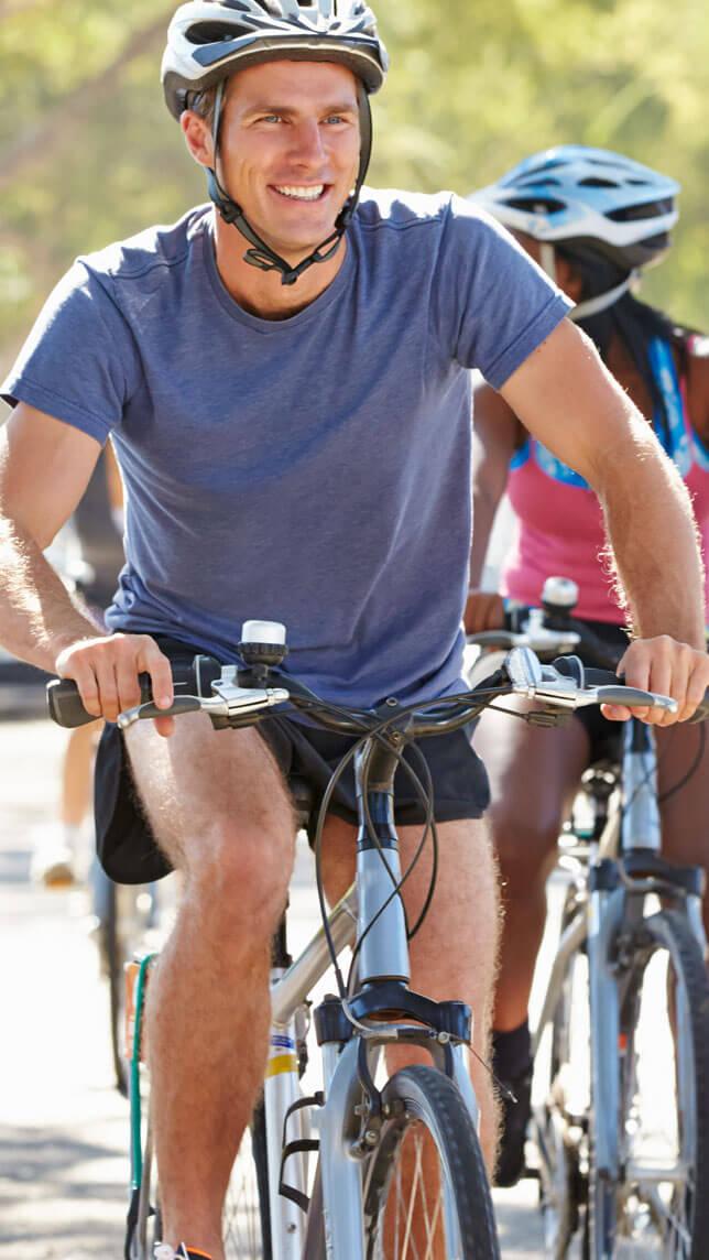 Michigan Pain Clinic Man on Bike Free of Pain